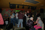 Patrons dancing and singing karaoke in the Crow's Nest
